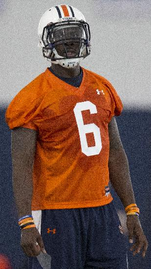 In this Aug. 1, 2014, file photo, Auburn quarterback Jeremy Johnson (6) waits for throwing drill instructions during the first day of NCAA college football practice in Auburn, Ala. Johnson says he has no idea if he's starting against Arkansas with starter Nick Marshall being held out for at least the opening. He does have one prediction: Marshall will win the Heisman Trophy
