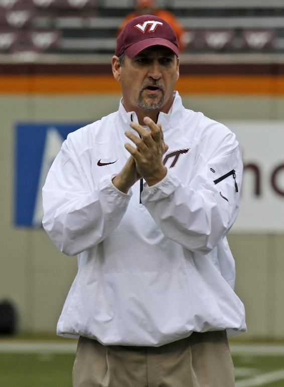 FILE  -  In a Nov. 16, 2013, file photo Virginia Tech defensive coordinator Bud Foster cheers his team prior to the start of the Maryland Virginia Tech NCAA college football game in  Blacksburg, Va. Foster loves it that some are calling Virginia Tech DBU, or Defensive Back U