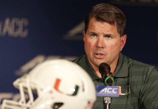 Miami head coach Al Golden answers a question during a news conference at the Atlantic Coast Conference Football kickoff in Greensboro, N.C., Monday, July 21, 2014