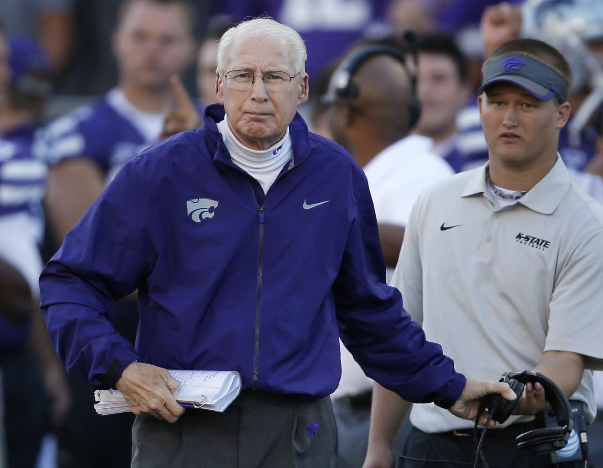 In this Oct. 12, 2013, file photo, Kansas State coach Bill Snyder takes off his headset to check on an injured player during the second half of an NCAA college football game against Baylor in Manhattan, Kan. The top three returning running backs for No. 20 Kansas State this season have combined to carry the ball 11 times for 55 yards. None of them has ever scored a touchdown