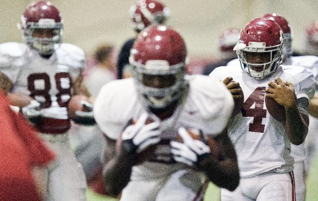 Alabama running back T.J. Yeldon (4) prepares for running drills during an NCAA college football practice at Hank Crisp indoor practice facility on Monday, Aug. 25, 2014, in Tuscaloosa, Ala