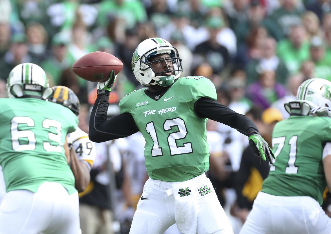 FILe - In this Nov. 2, 2013, file photo, Marshall quarterback Rakeem Cato passes during an NCAA college football game against Southern Mississippi in Huntington, W.Va. Cato enters his senior season with the chance to become the most prolific quarterback in school history