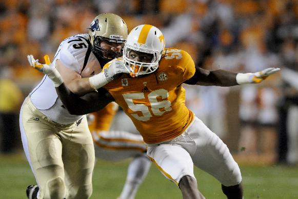 In this photo taken on Sept. 22, 2012, Tennessee outside linebacker and defensive end Curt Maggitt rushes against Akron during an NCAA college football game in Knoxville, Tenn