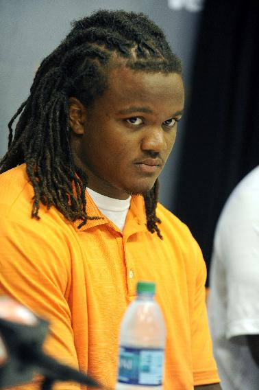 In this photo taken on July 31, 2014, Tennessee outside linebacker and defensive end Curt Maggitt talks to the media during an NCAA college football news conference in Knoxville, Tenn