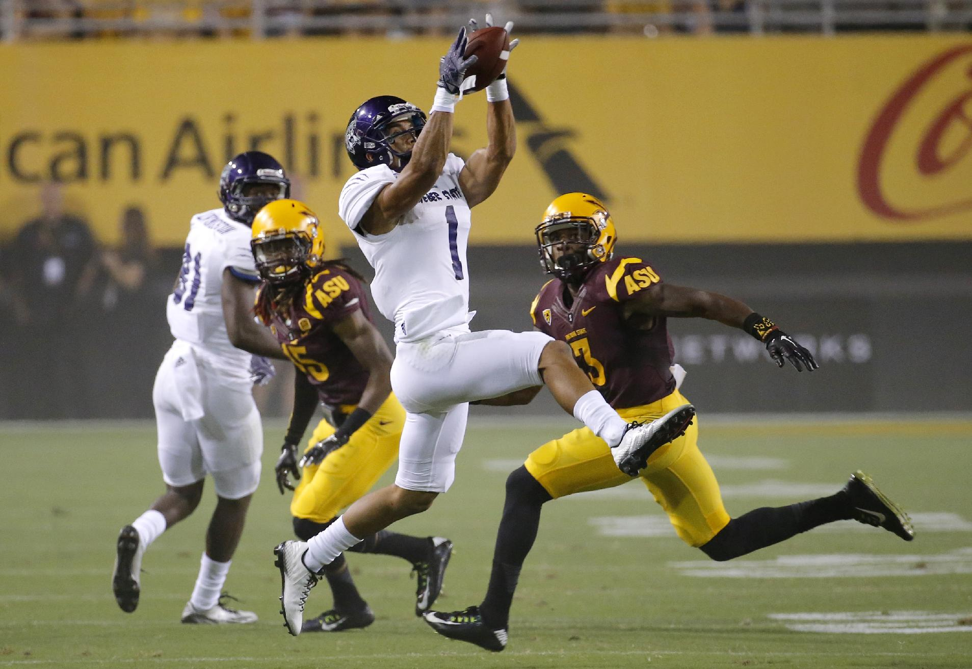 Weber State wide receiver Shaydon Kehano makes a catch as Arizona State defensive back Damarious Randall (3) watches during the first half of an NCAA college football game, Thursday, Aug. 28, 2014, in Tempe, Ariz