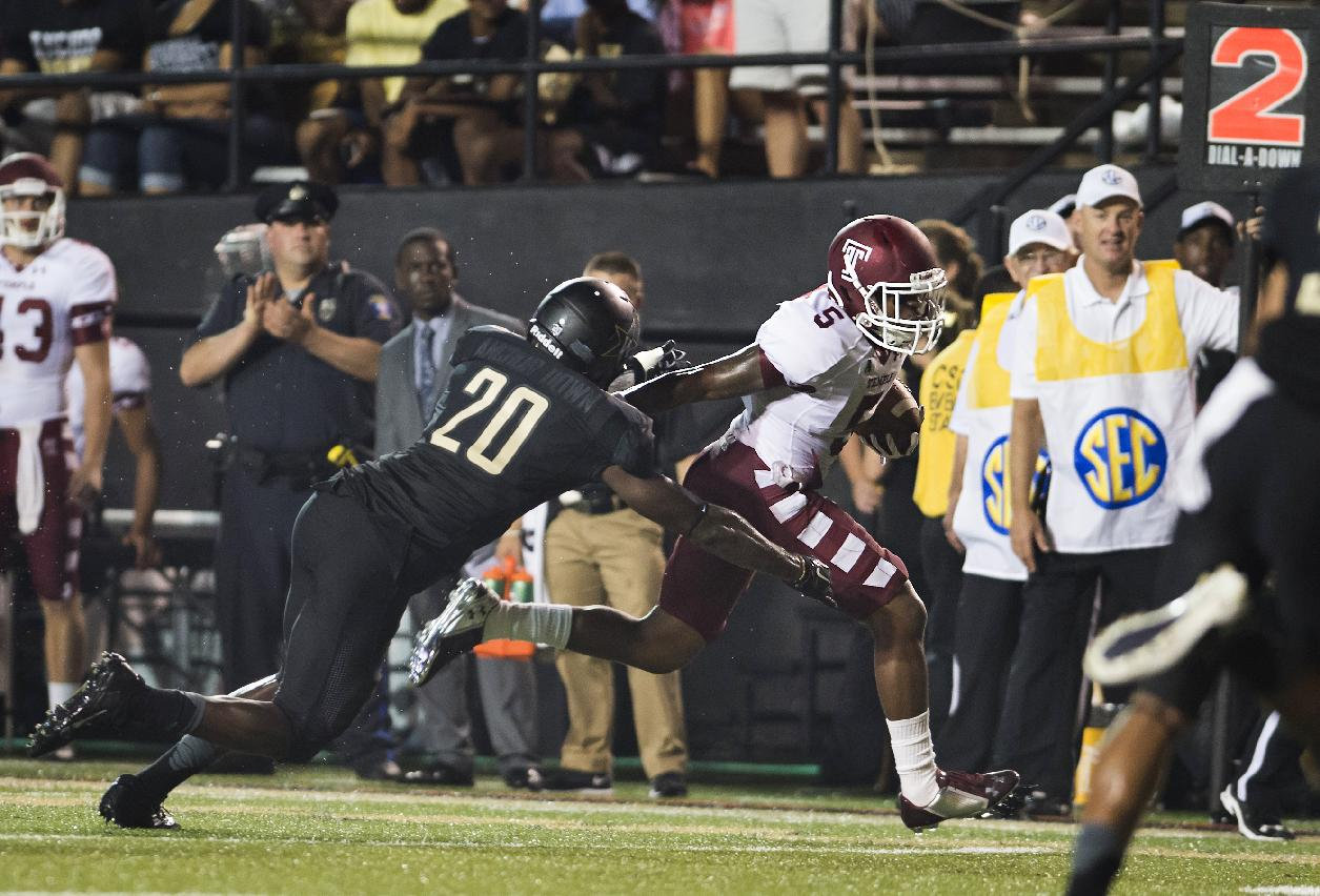 Temple's Jalen Fitzpatrick stiff-arm's Vanderbilt's Oren Burks on his way to a touchdown during the second quarter of an NCAA college football game Thursday, Aug. 28, 2014, in Nashville, Tenn