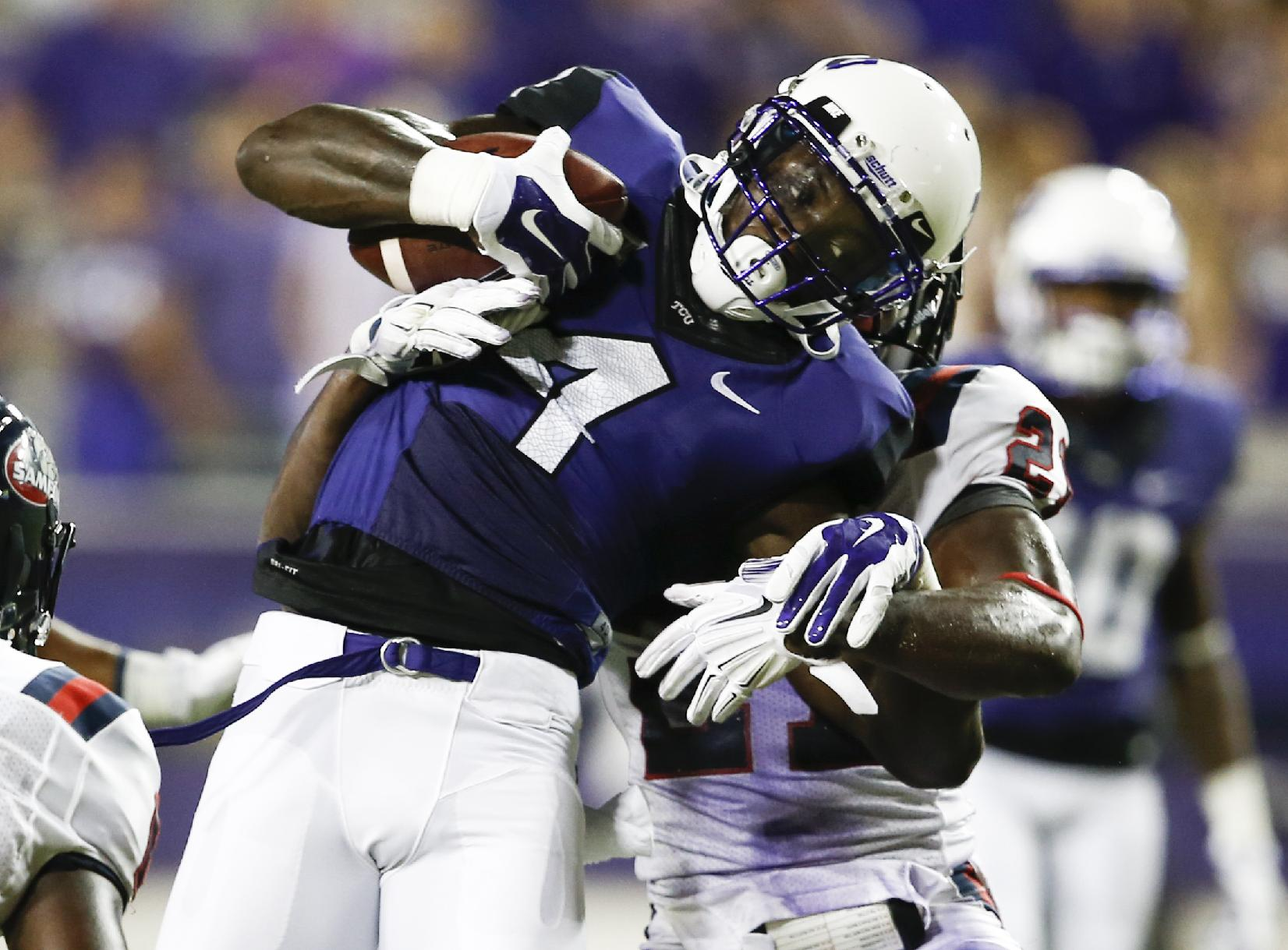 TCU wide receiver Jordan Moore (4) is tackled by Samford defensive back James Bradberry (21) after a catch in the second half of an NCAA college football game in Fort Worth, Texas, Saturday, Aug. 30, 2014. TCU won 48-14