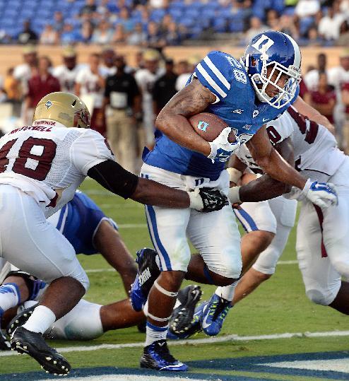Duke running back Shaquille Powell (28) scores a second-quarter touchdown as Elon linebacker Corey Mitchell (48) defends during an NCAA college football game Saturday, Aug. 30, 2014, in Durham, N.C. Duke won 52-13