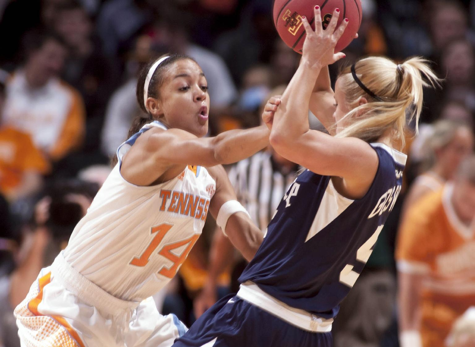 In a photo taken on Nov. 15, 2012, Tennessee guard Andraya Carter, left, pressures Rice University Jessica Goswitz during a NCAA women's college basketball game in Knoxville, Tenn. Carter's teammates say she developed into a team leader as a freshman last year despite missing most of the season with a shoulder injury. Now she's back on the floor and ready to boost a point guard position that lacked depth last season