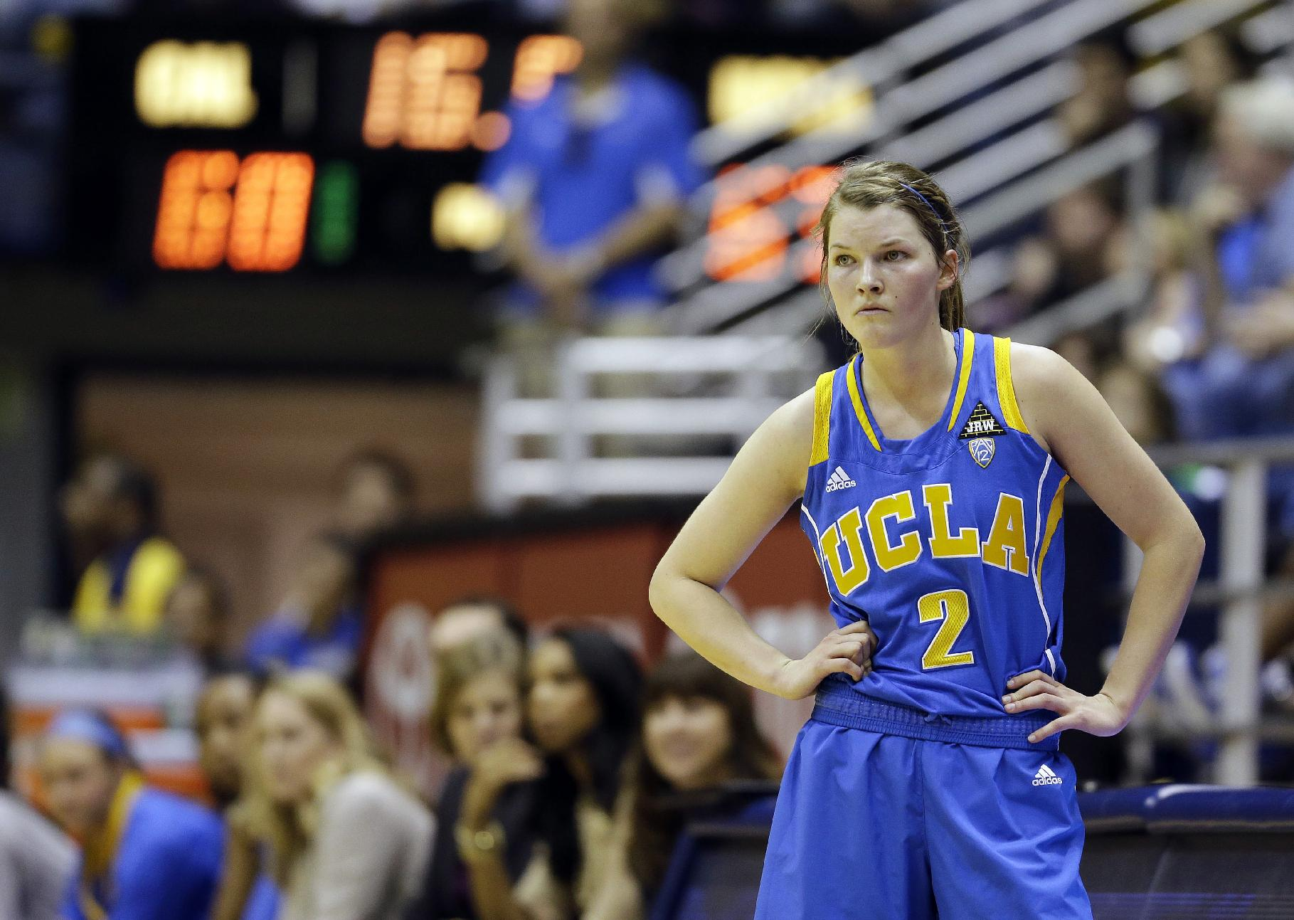 UCLA guard Kari Korver watches from the sidelines in the closing seconds of their NCAA college basketball game against California, Sunday, Jan. 20, 2013, in Berkeley, Calif. California won 70-65