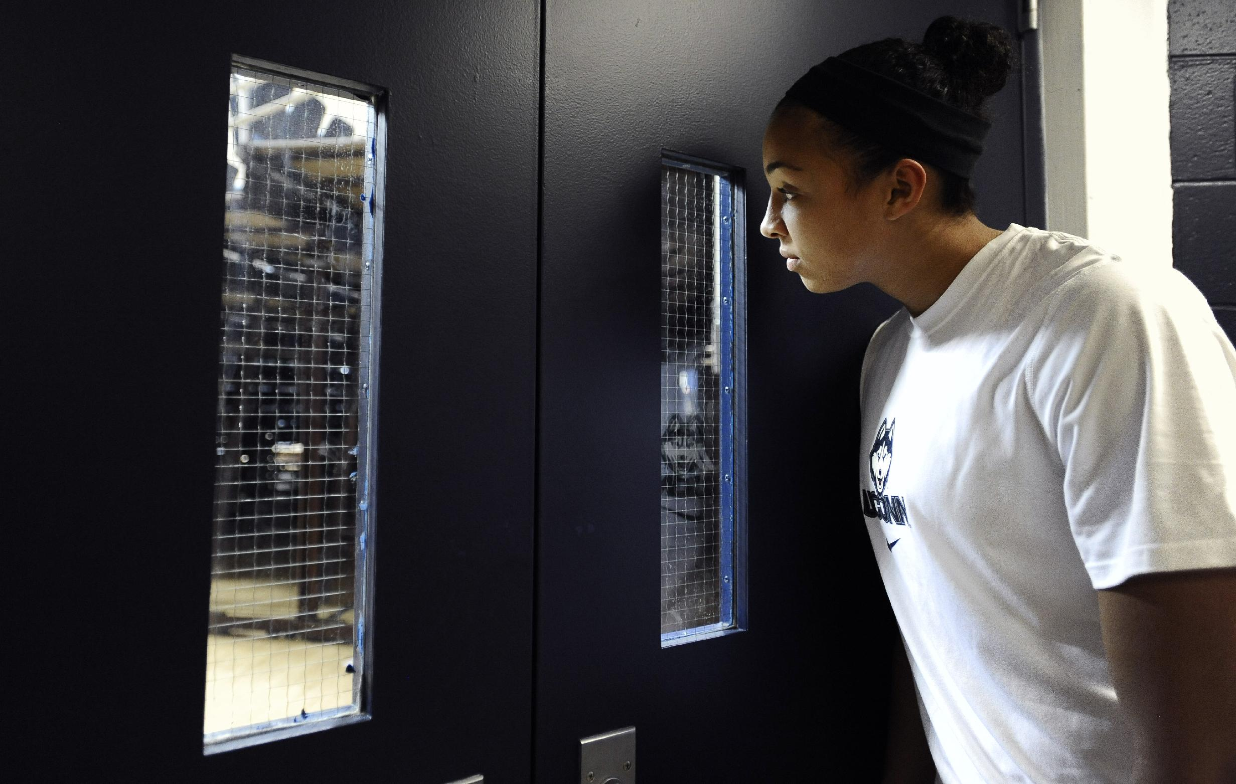 Connecticut's Kiah Stokes watches the men's basketball team during their NCAA college basketball media day, Monday, Sept. 30, 2013, in Storrs, Conn