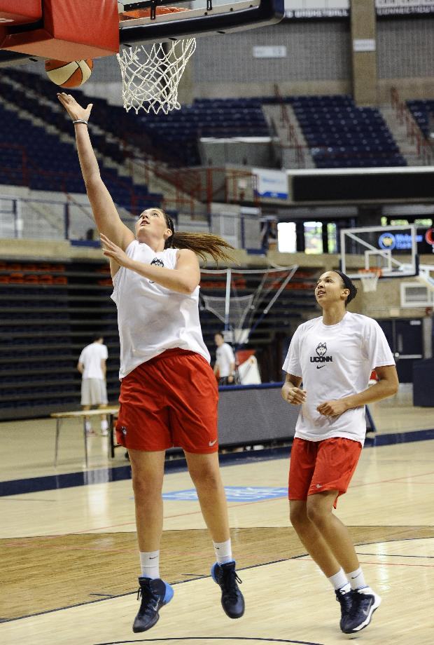 Connecticut's Stefanie Dolson, left, and Kiah Stokes, right, practice after the team's NCAA college basketball media day, Monday, Sept. 30, 2013, in Storrs, Conn