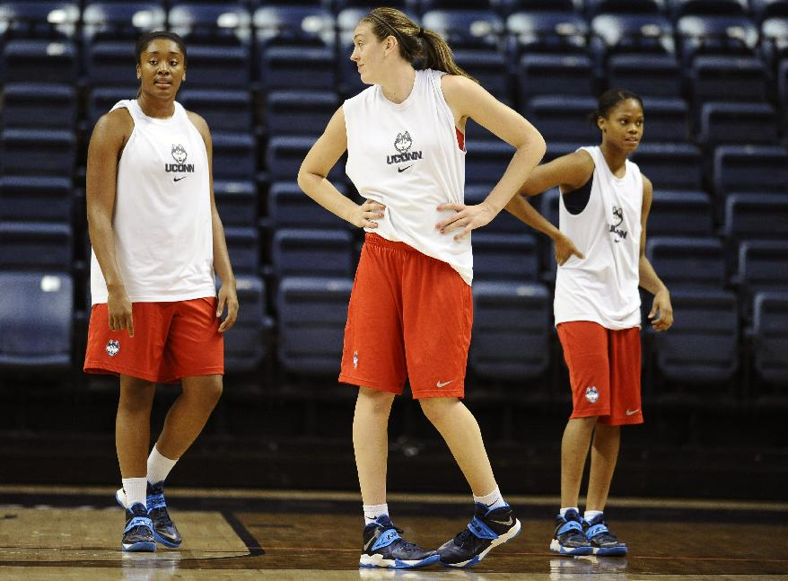 Connecticut's Morgan Tuck, left, Breanna Stewart, center, and Moriah Jefferson, right, practice after the team's NCAA college basketball media day, Monday, Sept. 30, 2013, in Storrs, Conn