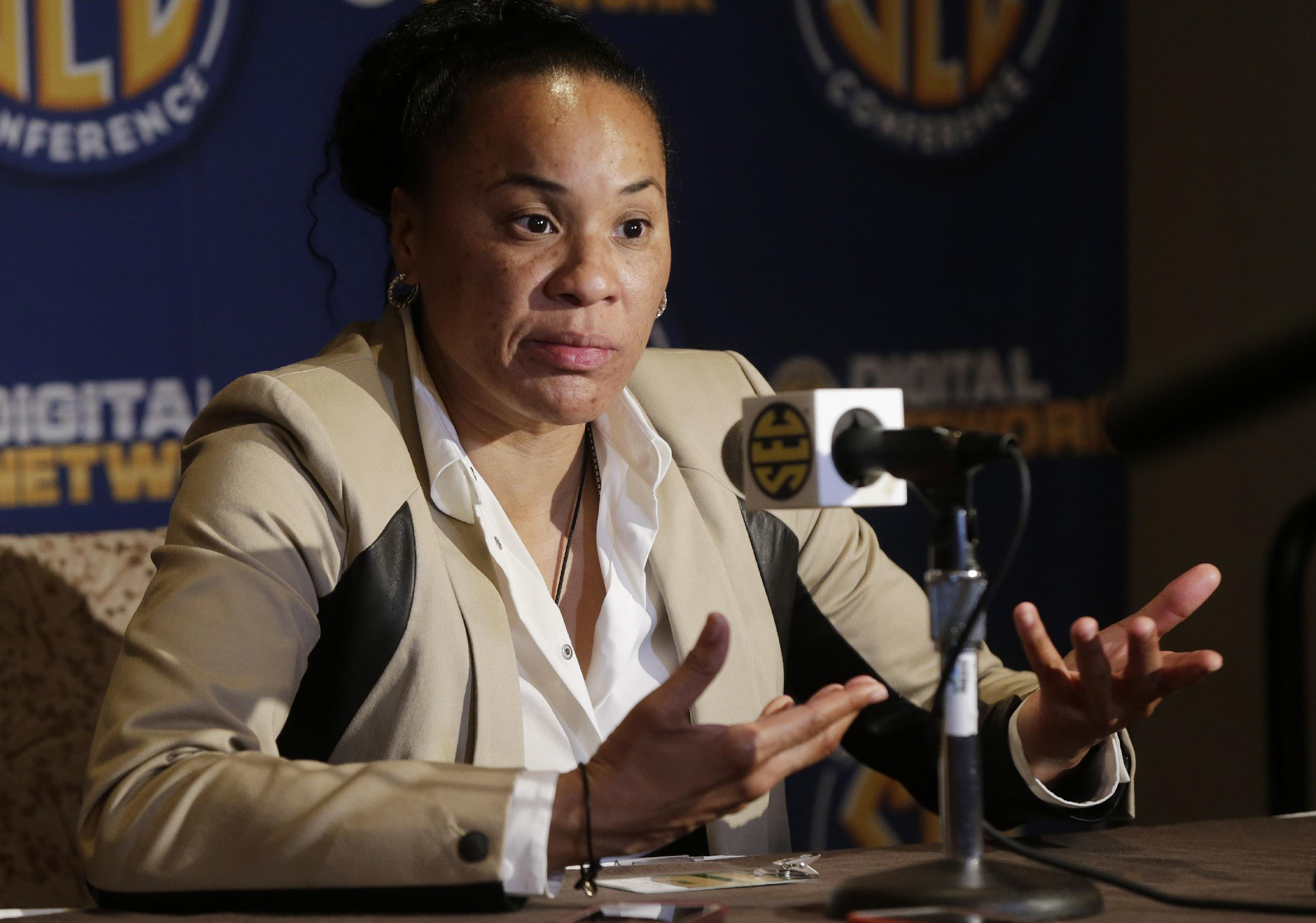 South Carolina coach Dawn Staley talks with reporters during Southeastern Conference NCAA college basketball media day in Birmingham, Ala., Thursday, Oct. 17, 2013