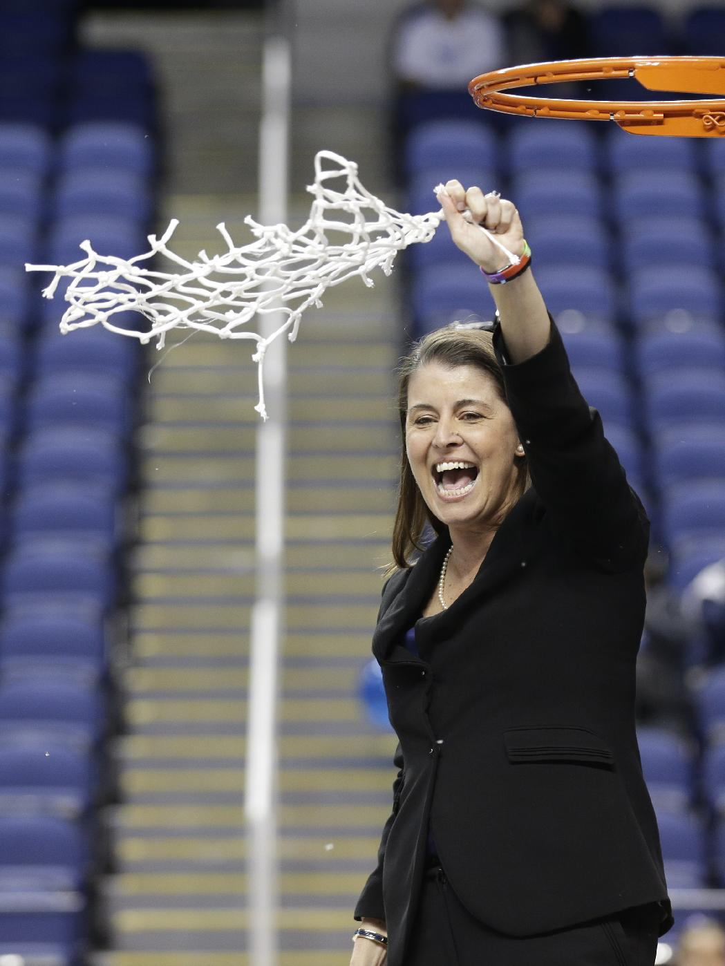 In this March 10, 2013 file photo, Duke head coach Joanne P. McCallie waves the net at fans and players after an NCAA college basketball game against North Carolina at the Atlantic Coast Conference tournament in Greensboro, N.C. Duke returns all five starters and its top seven scorers to build on its recent domination in the Atlantic Coast Conference