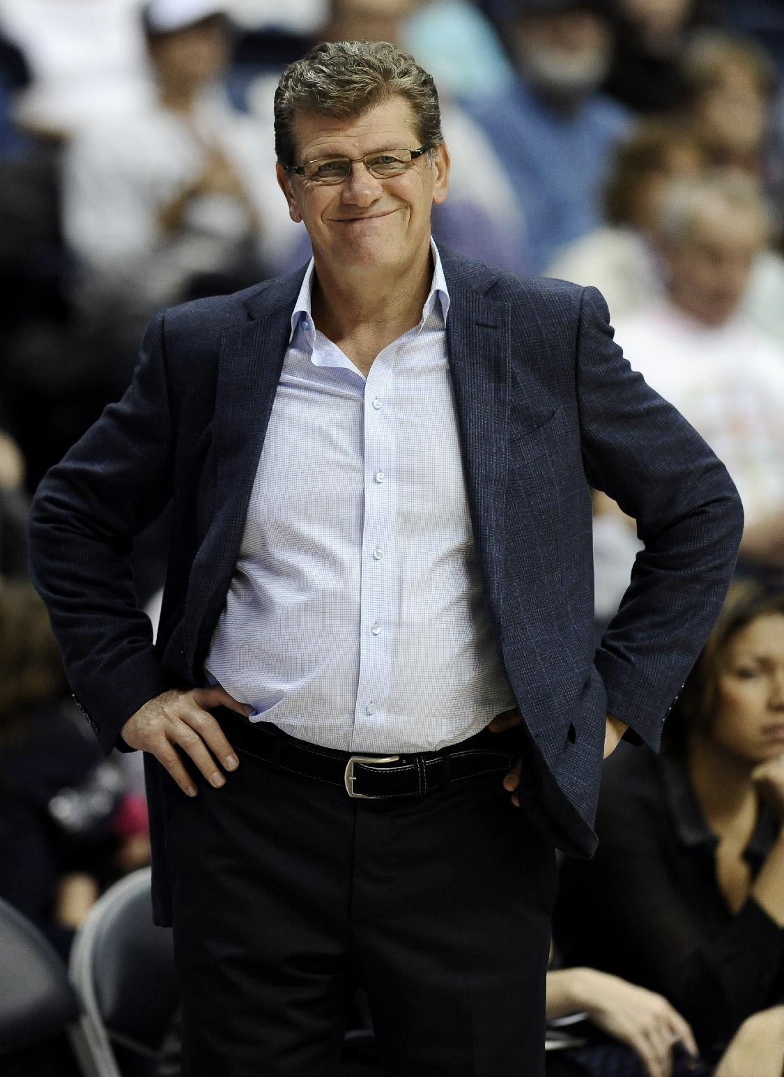 Connecticut coach Geno Auriemma smiles as he watches play during the second half of an NCAA college exhibition basketball game against Ganon, Friday, Nov. 1, 2013, in Storrs, Conn. Connecticut won 101-35