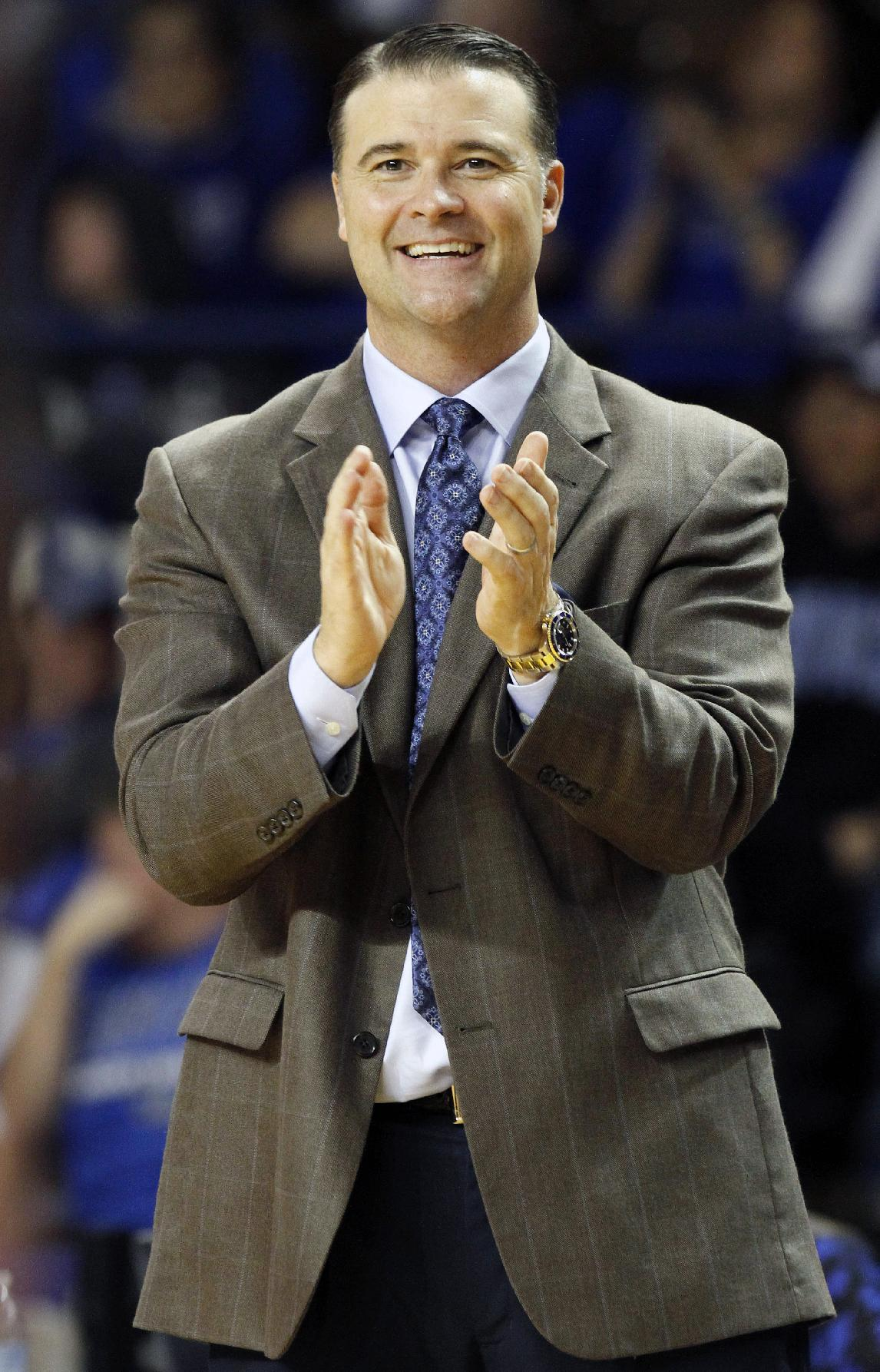 Kentucky head coach Matthew Mitchell applauds his team during the second half of an NCAA college basketball exhibition game, Sunday, Nov. 3, 2013, in Lexington, Ky