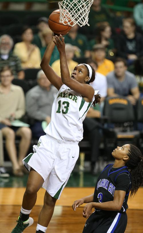 Baylor's Nina Davis, left, scores past Oklahoma City's Cetoria Petties, right, in the first half of an NCAA college basketball exhibition game, Tuesday, Nov. 5, 2013, in Waco, Texas