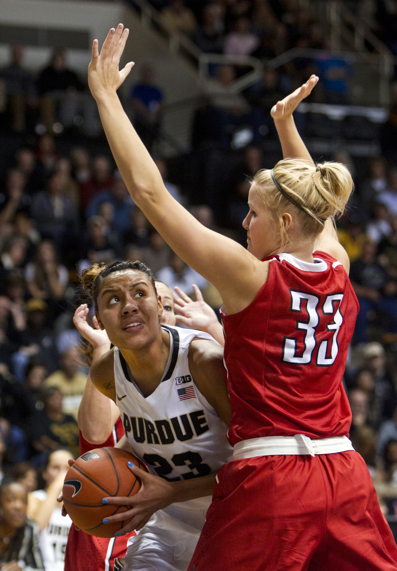 Purdue's Liza Clemons, left, tries to get around Ball State's Katie Murphy during an NCAA college basketball game Sunday, Nov. 10, 2013, in West Lafayette, Ind