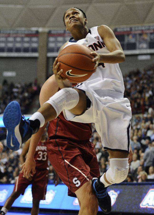 Connecticut's Moriah Jefferson, right, drives to the basket as Stanford's Mikaela Ruef, left, defends during the first half of an NCAA college basketball game, Monday, Nov. 11, 2013, in Storrs, Conn