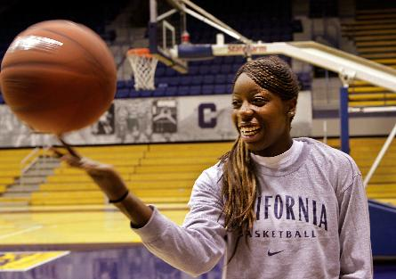 In this Oct. 9, 2009, file photo, California freshman forward Tierra Roger's plays with a basketball in Berkeley, Calif. The former California basketball player, who never played a single minute because of a rare heart condition that could have killed her, has that diploma in hand at last, four years after a frightening collapse that derailed her college career before it began. The highly touted guard stopped breathing outside the Cal training room in Sept. 2009