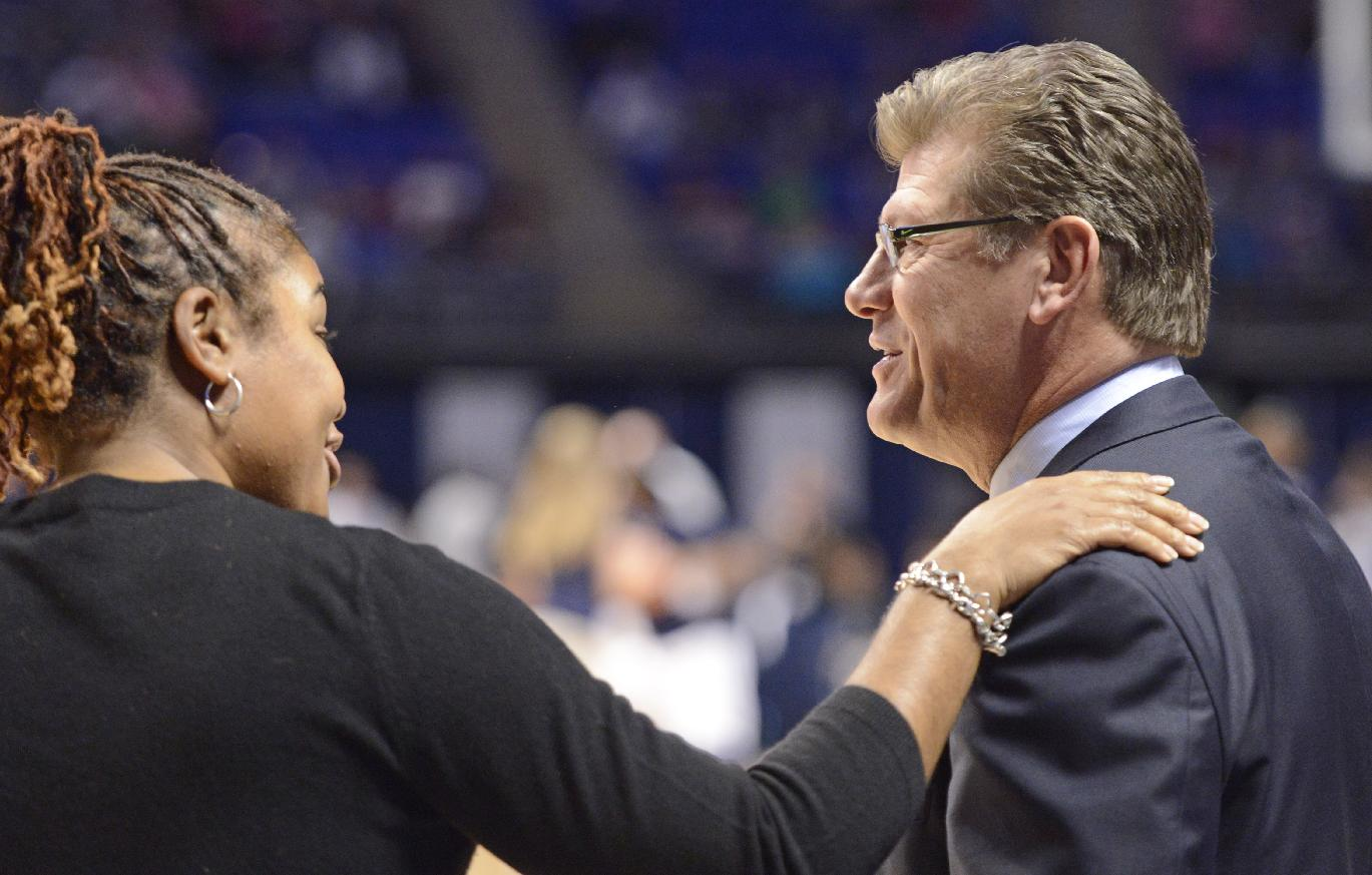 Connecticut head coach Geno Auriemma, right, talks with Penn State head coach Coquese Washington before their teams played in an NCAA college basketball game, Sunday, Nov. 17, 2013, in State College, Pa