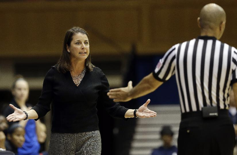 Duke coach Joanne P. McCallie, left, speaks with an official during the second half of an NCAA college basketball game against Vanderbilt in Durham, N.C., Thursday, Nov. 21, 2013