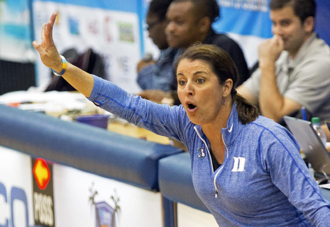 Duke head coach Joanne McCallie gives instructions to her players from the sidelines during the second half of an NCAA college basketball game against Central Michigan in St. Thomas, U.S. Virgin Islands, Friday, Nov. 29, 2013. Duke won 97-64