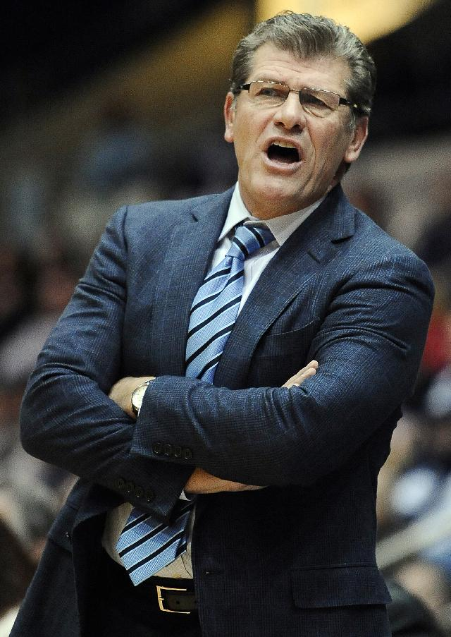 Connecticut head coach Geno Auriemma stands during the second half of an NCAA college basketball game against Ohio State, Sunday, Dec. 1, 2013, in Springfield, Mass. Connecticut won 70-49