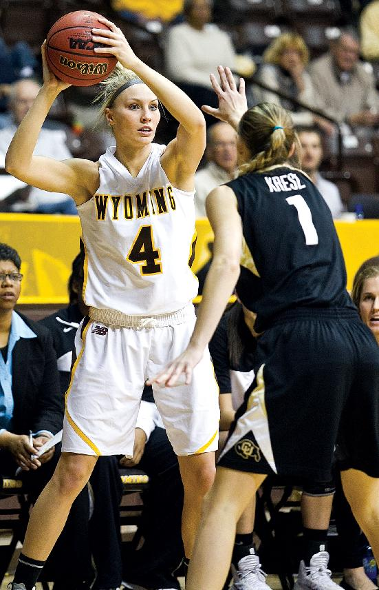 University of Wyoming Cowgirls junior forward Kayla Woodward (4) looks for an open teammate Wednesday Dec. 4, 2013 against University of Colorado in Laramie, Wyo. No. 11 Colorado slipped past Wyoming 63-59