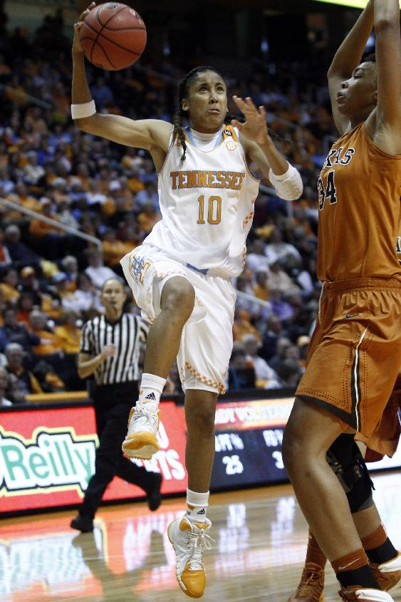 Tennessee guard Meighan Simmons (10) goes for a shot against Texas center Imani McGee-Stafford (34) in the second half of an NCAA college basketball game on Sunday, Dec. 8, 2013, in Knoxville, Tenn. Tennessee won 75-61