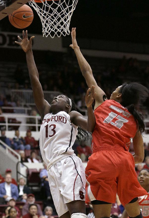 Stanford forward Chiney Ogwumike, left, shoots against New Mexico forward Khadijah Shumpert (13) during the second half of an NCAA women's college basketball game in Stanford, Calif., Monday, Dec. 16, 2013. Stanford won 75-41