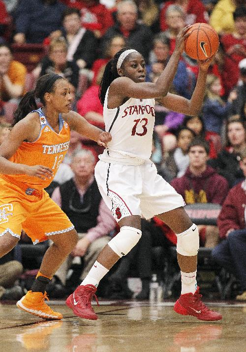 Stanford forward Chiney Ogwumike (13) looks for the ball against Tennessee forward Bashaara Graves (12) during the first half of an NCAA women's college basketball game, Saturday, Dec. 21, 2013, in Stanford, Calif