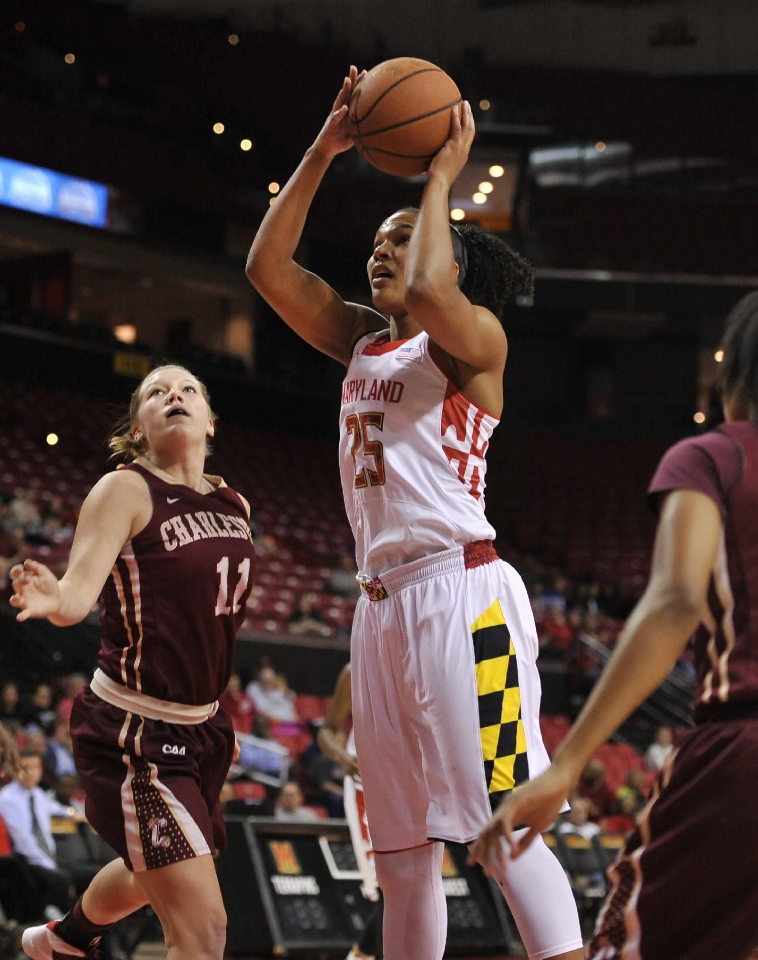 Maryland's Alyssa Thomas, center, shoots as Charleston's Christy Hewatt, left, defends in the first half of an NCAA basketball game Sunday, Dec. 29, 2013, in College Park, Md