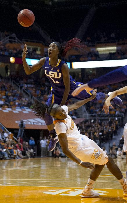 LSU guard Raigyne Moncrief (11) collides withTennessee forward Jasmine Jones (2) and is called for charging during an NCAA college basketball game at Thompson-Boling Arena in Knoxville, Tenn., on Thursday, Jan. 2, 2014.  LSU won 80-77