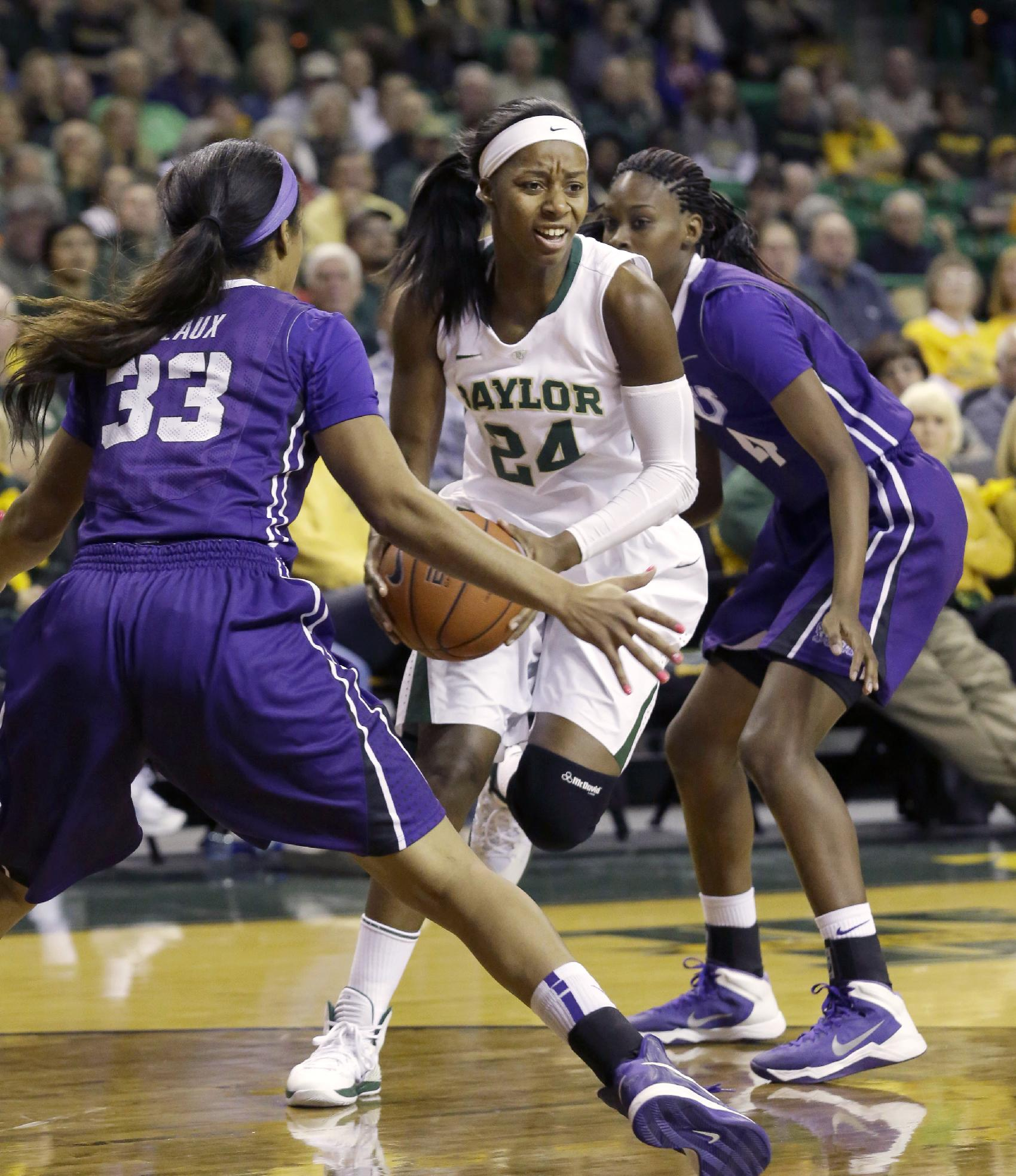Baylor guard Ieshia Small (24) drives between TCU guard Donielle Breaux (33) and forward Chelsea Prince (4) during the first half of an NCAA college basketball game, Saturday, Jan. 11, 2014, in Waco, Texas