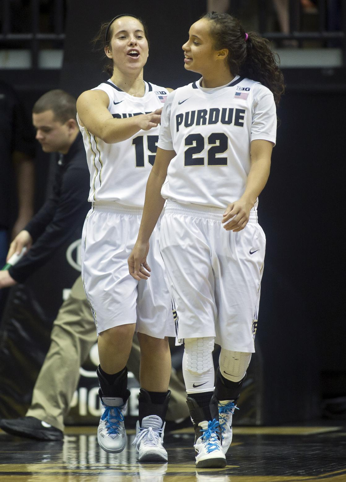 Purdue's Courtney Moses (15) congratulates teammate KK Houser after Houser took a charging foul during an NCAA college basketball game against Indiana, Friday, Jan. 17, 2014, in West Lafayette, Ind. Purdue won 86-53