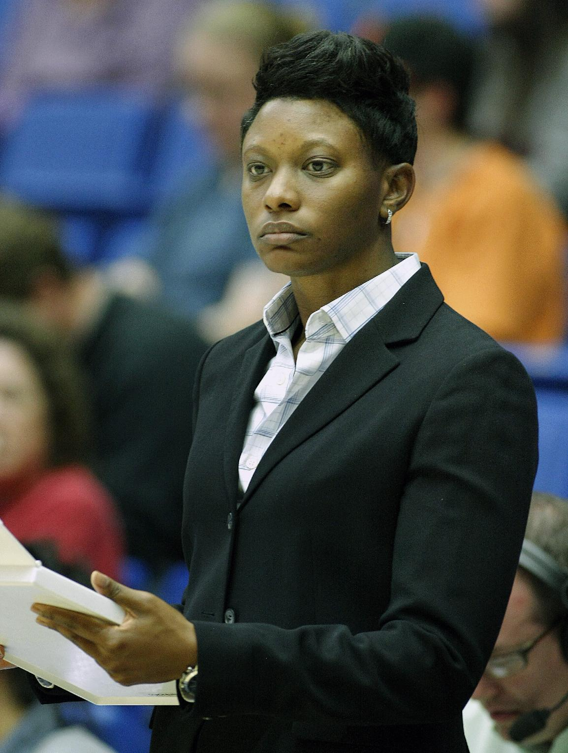 Arizona's Head Coach Niya Butts stands on the sideline before the start of an NCAA college basketball game against Stanford on Friday, Jan. 17, 2014, in Tucson, Ariz