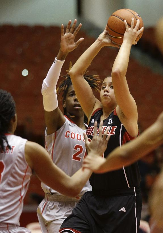 Louisville guard Shoni Schimmel takes a shot over the University of Houston center Yasmeen Thompson during the first half of an NCAA women's basketball game, Tuesday, Jan. 21, 2014, in Houston. Louisville defeated the University of Houston 93 - 52