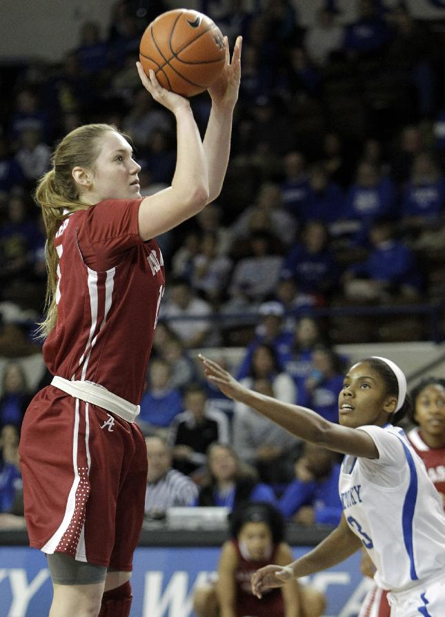 Alabama's Nikki Hegstetter shoots over Kentucky's Janee Thompson during the first half of an NCAA college basketball game, Thursday, Jan. 23, 2014, in Lexington, Ky