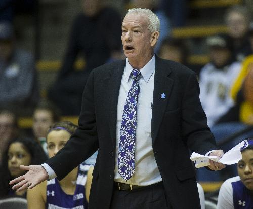 Northwestern coach Joe McKeown questions an official's call during an NCAA college basketball game against Purdue on Thursday, Jan. 23, 2014, in West Lafayette, Ind. Purdue won 90-65