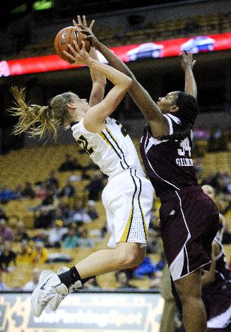 Missouri's Jordan Frericks (22) is blocked by Texas A&M's Karla Gilbert (34) during an NCAA college basketball game Thursday, Jan. 23, 2014, in Columbia, Mo. Texas A&M won 62-57