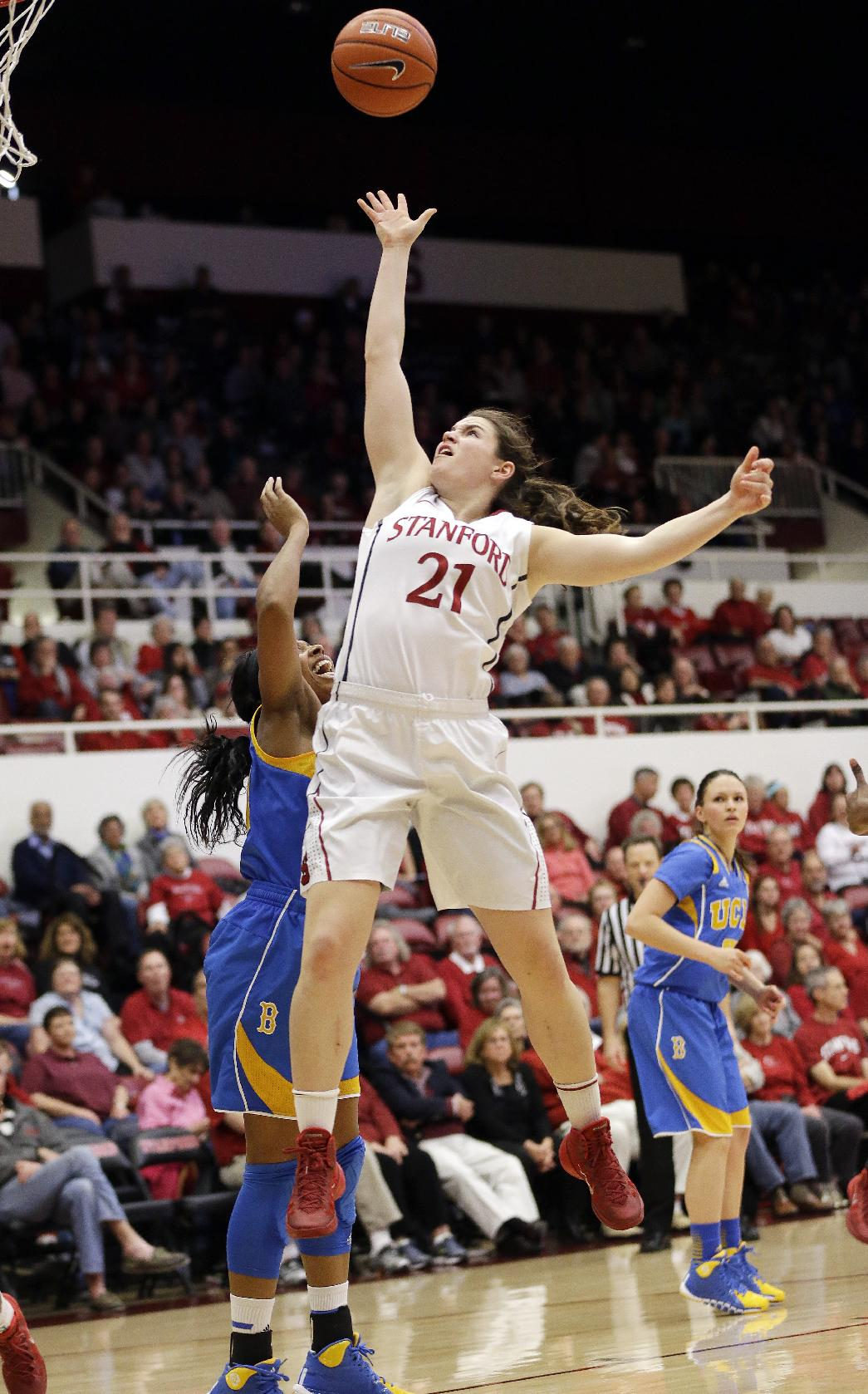 Stanford's Sara James (21) scores against UCLA during the first half of an NCAA college basketball game Friday, Jan. 24, 2014, in Stanford, Calif