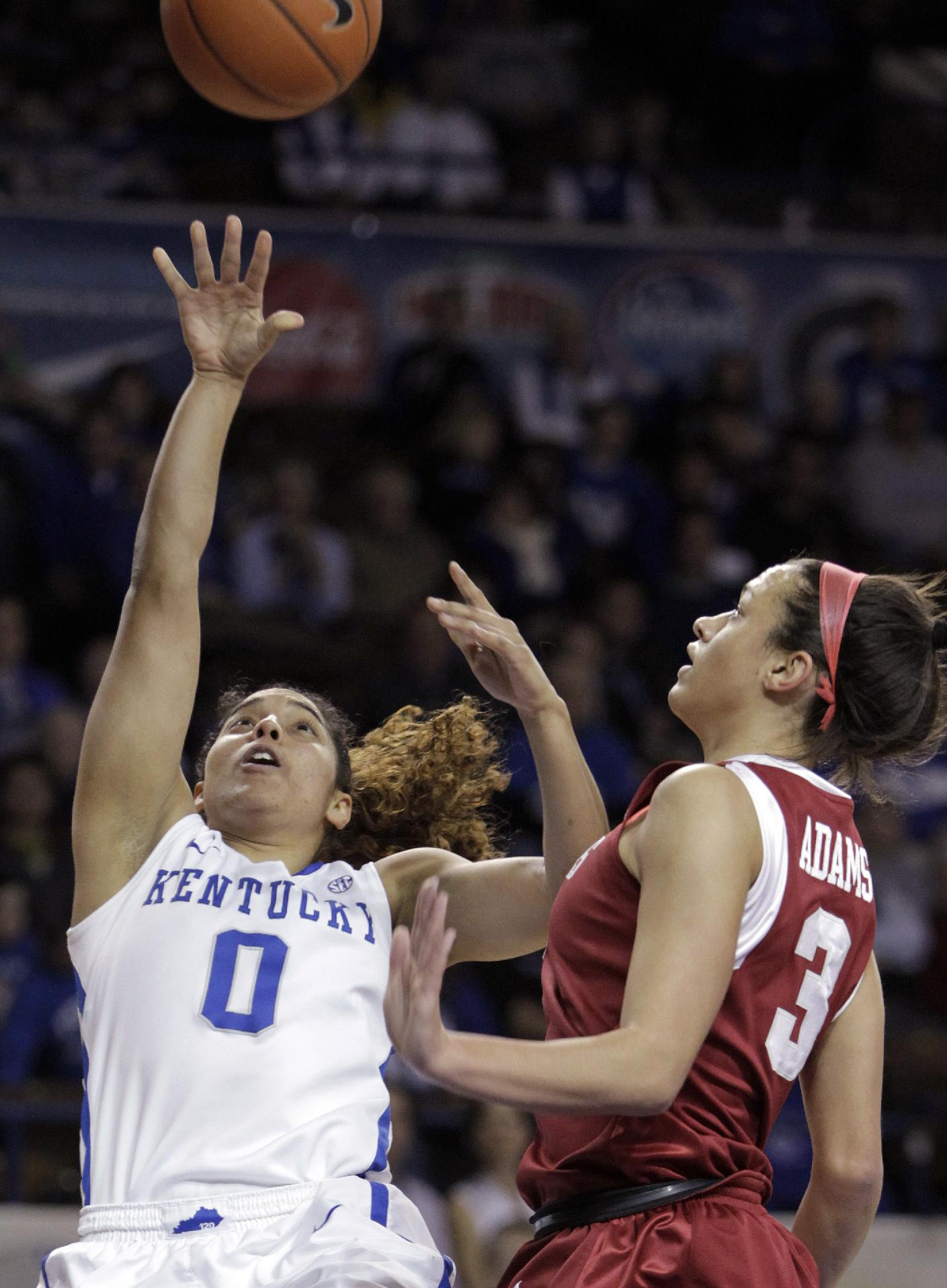 Kentucky's Jennifer O'Neill (0) shoots as Arkansas' McKenzie Adams (3) defends during the first half of NCAA college basketball game, Sunday, Jan. 26, 2014, in Lexington, Ky