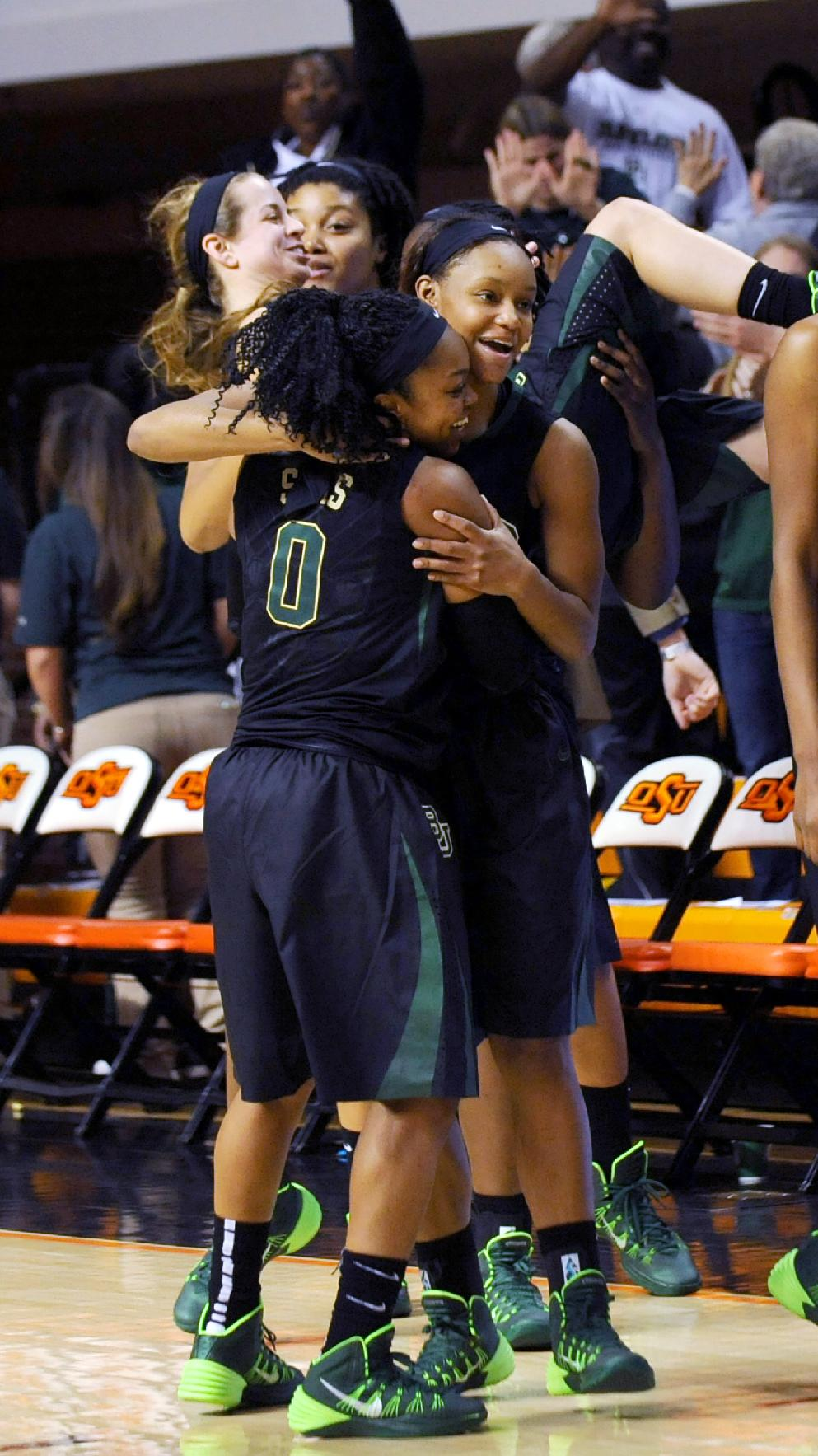 Baylor guard Odyssey Sims, left, and forward Nina Davis hug in celebration following an NCAA college basketball game in Stillwater, Okla., Sunday, Jan. 26, 2014. Sims had 17 points in the 69-66 win over Oklahoma State