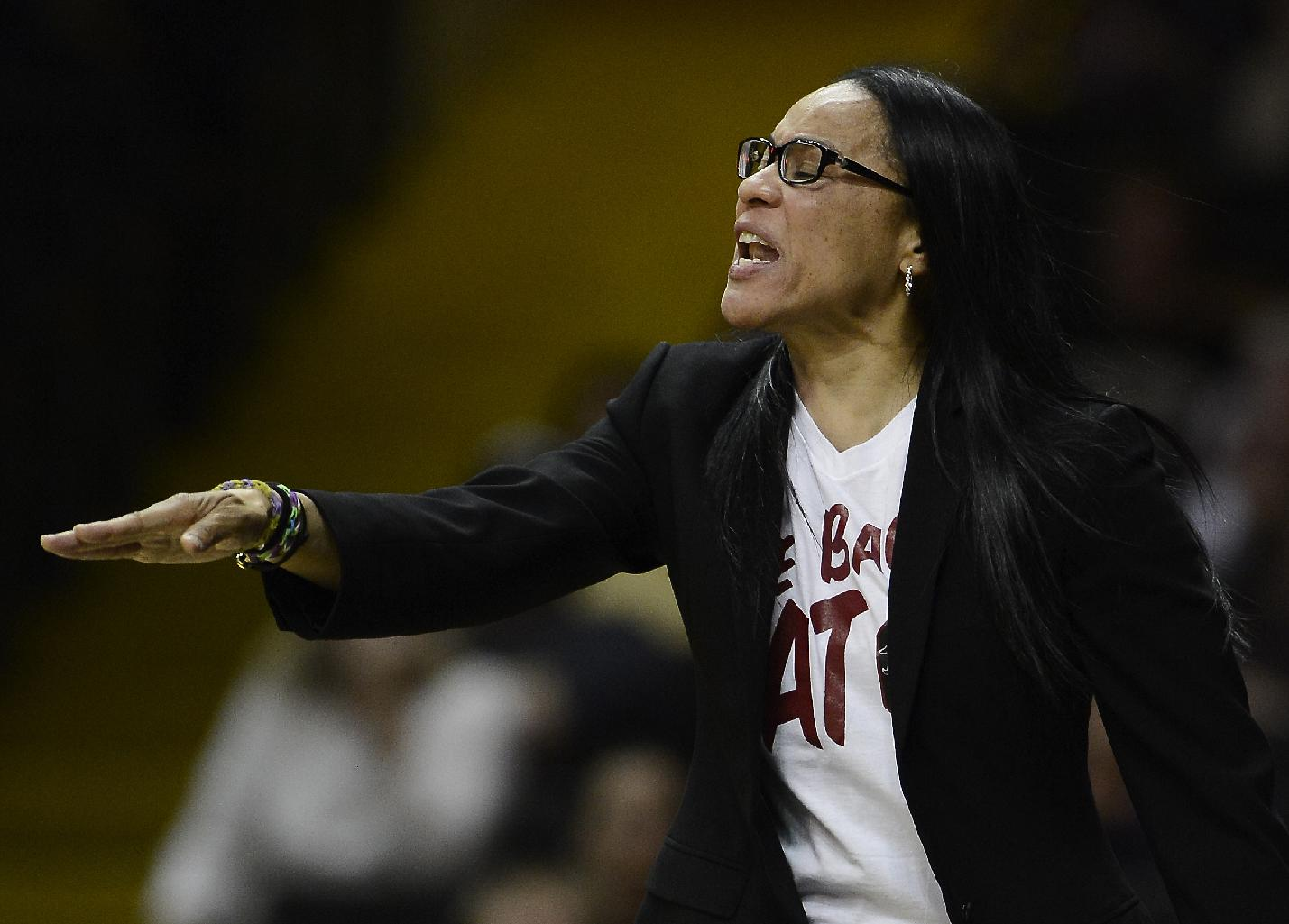 South Carolina head coach Dawn Staley directs her team against Vanderbilt in the second half of an NCAA college basketball game, Sunday, Jan. 26, 2014, in Nashville, Tenn. South Carolina won 61-57