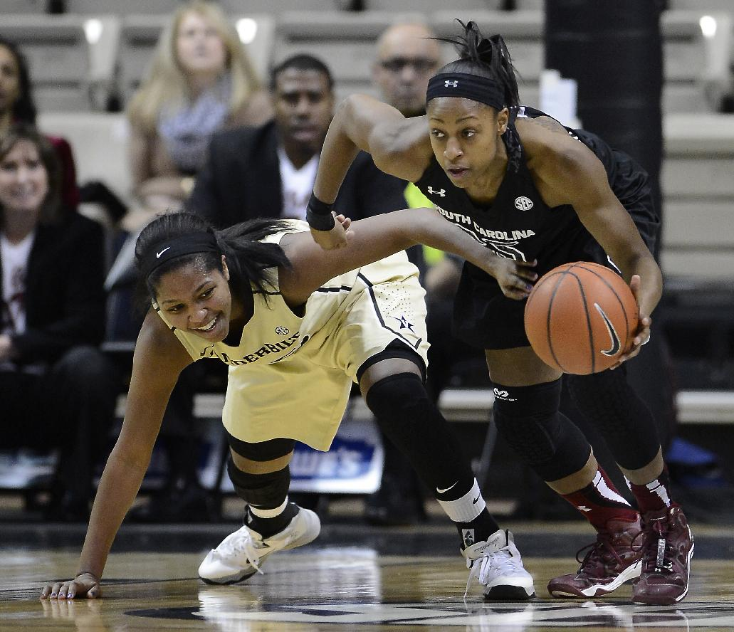 South Carolina guard Tiffany Mitchell, right, steals the ball away from Vanderbilt guard Morgan Batey in the first half of an NCAA college basketball game Sunday, Jan. 26, 2014, in Nashville, Tenn