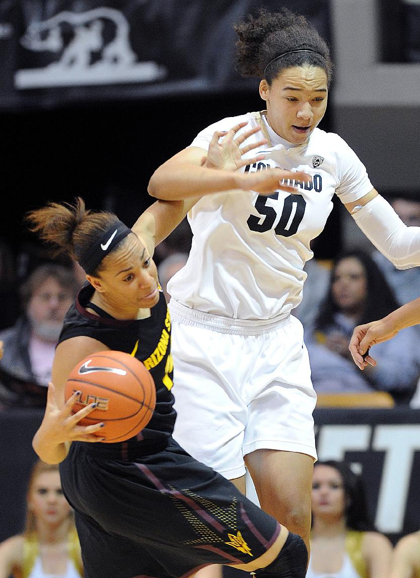 Arizona State's Adrianna Thomas tries to keep the ball from Colorado's Jamee Swan during the first half of an NCAA college basketball game, Jan. 26, 2014, in Boulder, Colo
