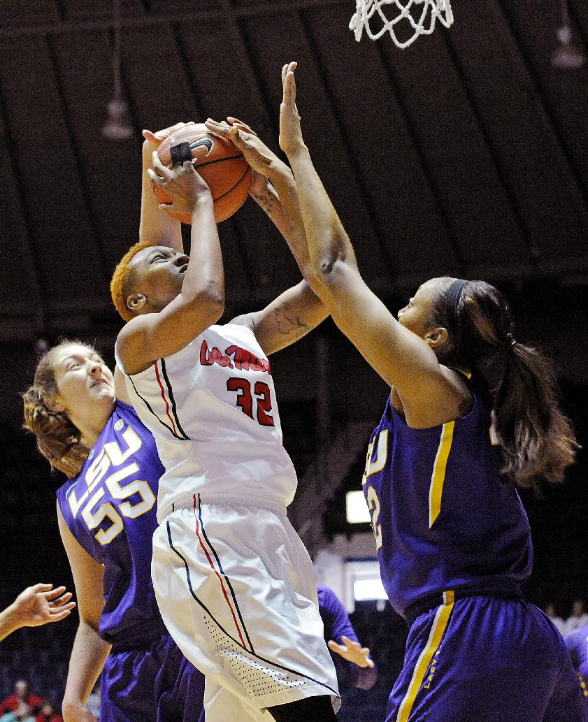 LSU forward Theresa Plaisance (55) and forward Sheila Boykin (42) block a shot by Mississippi forward Tia Faleru (32) during the first half of an NCAA college basketball game in Oxford, Miss., Sunday, Jan. 26, 2014