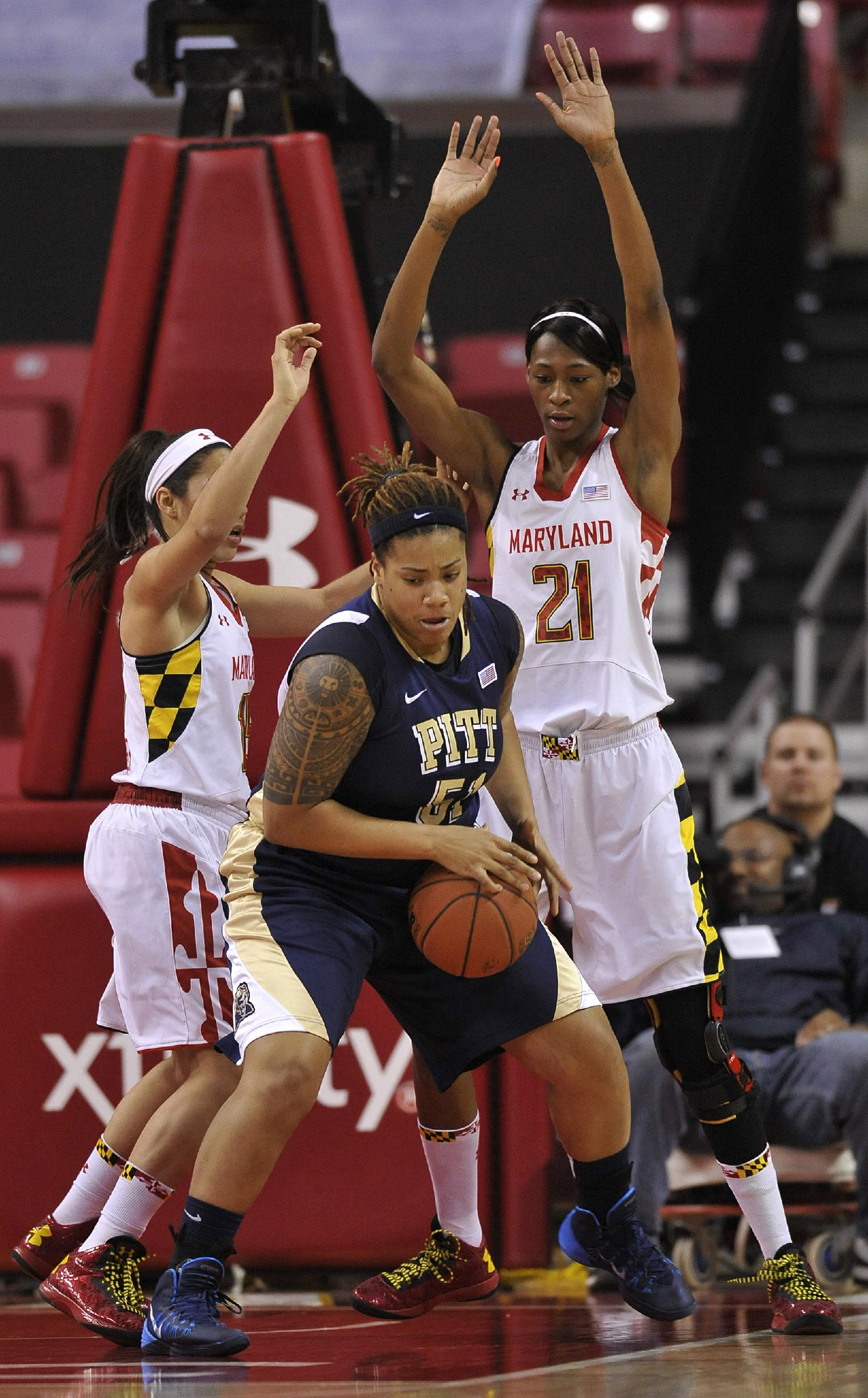 Pittsburgh's Cora McManus (51) is double-teamed by Maryland center Essence Townsend (21) and guard Chloe Pavlech (15) during the second half of an NCAA college basketball game Thursday, Feb. 6, 2014, in College Park, Md. Maryland won 94-46